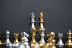 Two King Chess and the army on the black background. Chess board is the intelligence strategy game to make ideas for business and marketing concept, the success stock photo