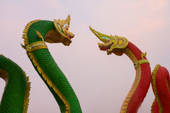 Two King of Nagas that confront each other. With Twilight sky Royalty Free Stock Images