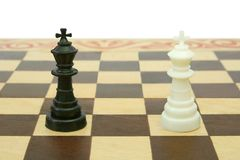 Two kings on chessboard (tie). Isolated on white background Royalty Free Stock Images
