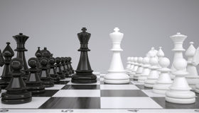 Two kings in the middle of a chessboard Stock Photography