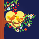 Two kissing birds on the tree stock illustration