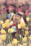 Two kissing dolls in garden. Stock Photos