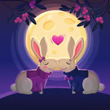 Two kissing rabbits on the moon background. Stock Images