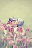 Two kissing vintage dolls. Royalty Free Stock Images
