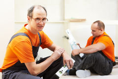Two kitchen installers at carpenter work Stock Photography
