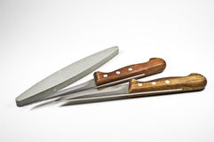 Two kitchen knife and a whetstone Royalty Free Stock Photography