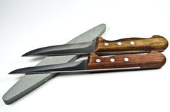 Two kitchen knife and whetstones Royalty Free Stock Photos