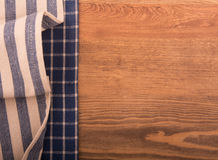 Two kitchen towels on dark wood Stock Photos