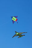 Two kites against a blue sky. Two kites with a strings flying against a blue sky Royalty Free Stock Photos