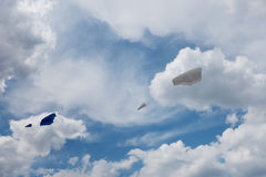 Two kites fly in the cloudy sky Stock Image