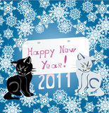 Two kittens and snowflakes Stock Photography