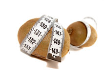 Two kiwi wrapped with measuring tape Royalty Free Stock Photo