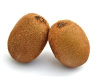 Two kiwis. A side by side isolated on white background royalty free stock image