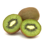 Two Kiwis. Two halves of a kiwi and a whole kiwi in background Stock Images