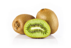 Two kiwis and a half. Two beautiful ripe kiwi and one half on a white background stock photography
