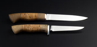 Two knifes on a black background Stock Image