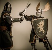 Two knights battle. Fight between two medieval knight Royalty Free Stock Images