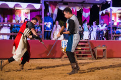 Two knights fighting. Alburquerque, Spain - august 19, 2017: Two knights fighting during Medieval  festival in Alburquerque, Extremadura, Spain Royalty Free Stock Photos