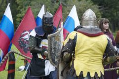 Two knights fighting with swords royalty free stock images