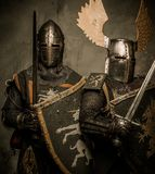 Two knights standing side by side. Two medieval knight in full armour Stock Photo