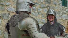 Two knights talking and laughing stock footage