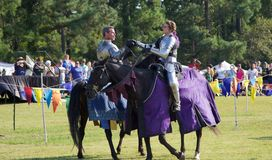 Two Knights Thumb wrestle at midfield at the Inaugural Mid-South Renaissance Faire. Stock Photography