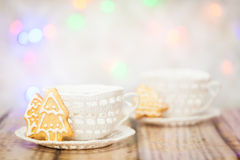 Two knitted cups and christmas cookies Stock Images