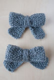 Two knitted gray bows Royalty Free Stock Images