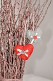 Two knitted hearts hanging on a branch. Symbol of love and Valentine`s day celebratione. Toned foto.  stock image