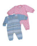 Two knitted pink and blue rompers. Stock Image