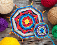 Two knitted tibetan mandala from threads and yarn Royalty Free Stock Images