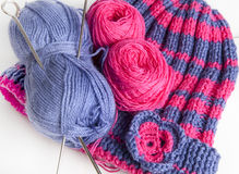 Something to do. Two knitting needles, woolen yarn (worsted) clew and knitting cap stock photo