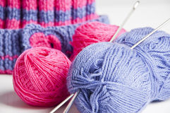 Something to do. Two knitting needles, woolen yarn (worsted) clew and knitting cap royalty free stock image