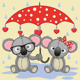 Two Koalas with umbrella Stock Images