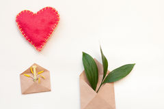 Two kraft envelopes with leaves and tulip pestle and heart Royalty Free Stock Photography