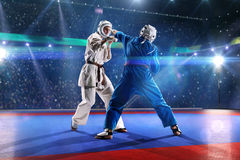 Two kudo fighters are fighting on the grand arena Royalty Free Stock Photography