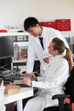 Two lab technicians discussing their work Stock Image
