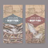 Two labels with old fishing boat, color fish and seafood basket on cardboard. Set of two labels with fishing boat, color fish and seafood basket placed on Royalty Free Stock Images