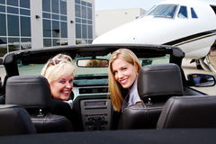 Two laddies arriving at jet Stock Photos
