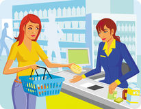 Two ladies. Two girls in shop at cash department Stock Image
