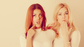 Two ladies in awkward moment. Royalty Free Stock Image