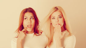 Two ladies in awkward moment. Royalty Free Stock Photo