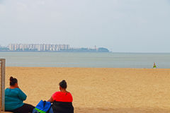 Two ladies on the beach mumbai india Royalty Free Stock Image