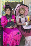 Two ladies on a bench. SOULAC SUR MER, FRANCE - JUNE 4: portrait of two ladies at the Soulac 1900 festival june 4, 2011, in Soulac sur mer, France. Every year royalty free stock photography