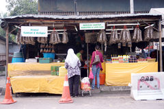 Two ladies buying a food, street hawker. Kuala Lumpur, Malaysia – October 17, 2015.  Two ladies buying a food, street hawker at Kampung Baru, Kuala Lumpur Royalty Free Stock Photos