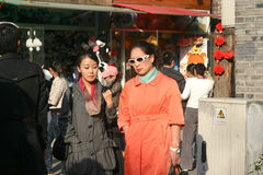 Two ladies contemplating. Something in beijing nanluoguxiang hutong royalty free stock photography