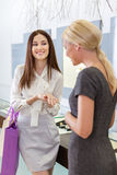 Two ladies discuss purchases and engagement ring Royalty Free Stock Photos