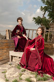 Two ladies in glamour vintage clothes on a boat Royalty Free Stock Photo