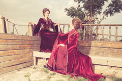 Two ladies in glamour vintage clothes on a boat Stock Photos