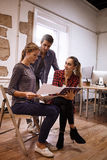 Two ladies and a guy discussing Royalty Free Stock Photography